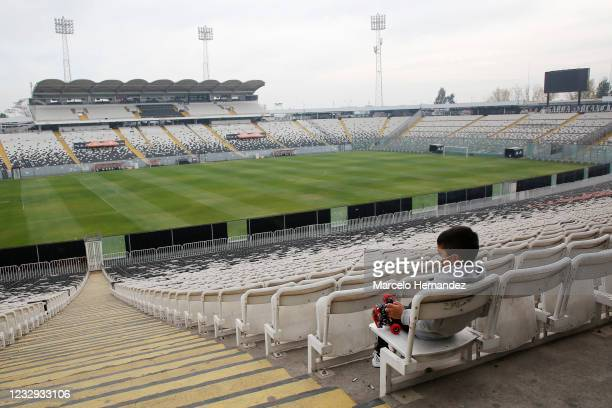 Boy waits for his father to vote at Monumental Stadium during Constitutional Convention Elections weekend on May 16, 2021 in Santiago, Chile. After...