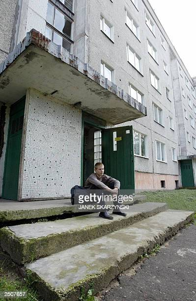 A boy waits for his parents in front of his house in Bouderia district Riga a former Russian military base mainly populated by Russians Out of the 23...