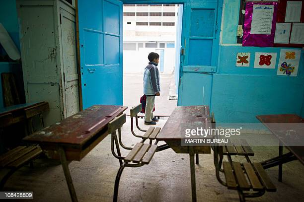 Boy waits in his school in the center of Tunis on January 24, 2011. Many primary schools remained shut on January 24 despite a government order to...