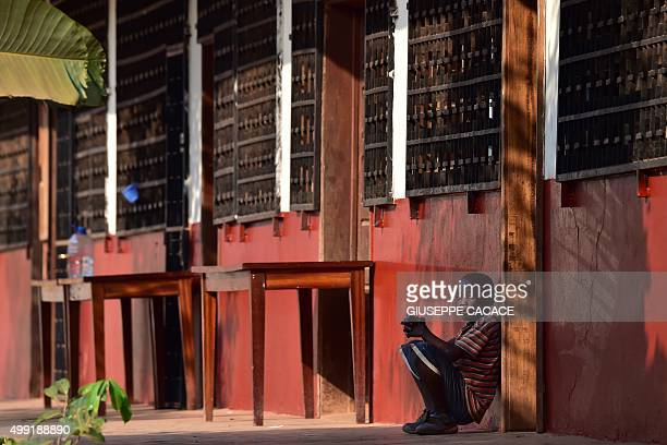 A boy waits the visit of Pope Francis at the Evangelic community in Bangui on November 29 2015 Pope Francis arrived as 'a pilgrim of peace' in...