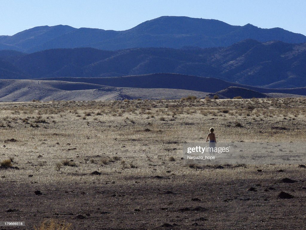 Boy Walking Alone In A Desert Stock Photo Getty Images