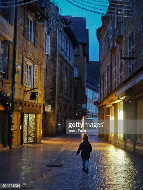 boy walking at sunrise in sarlat-la-candea, france - sarlat stock photos and pictures
