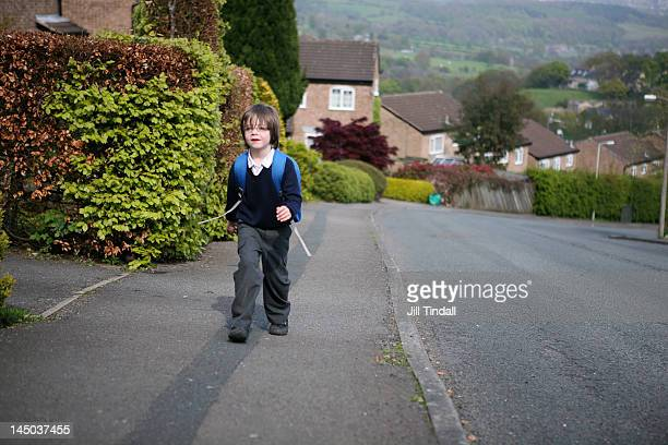 boy walking home from school - bradford england stock pictures, royalty-free photos & images