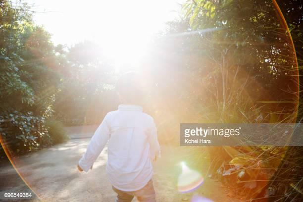 Boy walking in the park