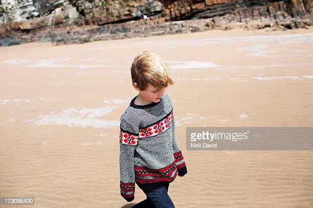 boy walking on a beach - david cliff stock pictures, royalty-free photos & images