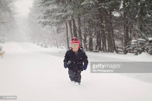 boy walking on street snowing - pomona new york state stock pictures, royalty-free photos & images
