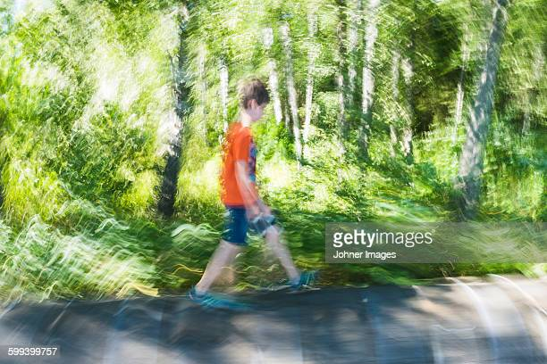boy walking through forest - dalsland stock photos and pictures