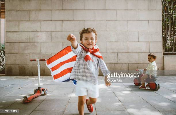 boy walking with american flag - 2 5 months stock pictures, royalty-free photos & images