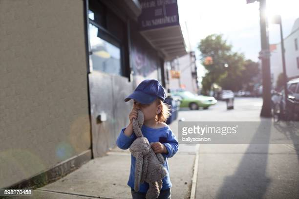 boy walking with cuddly toy