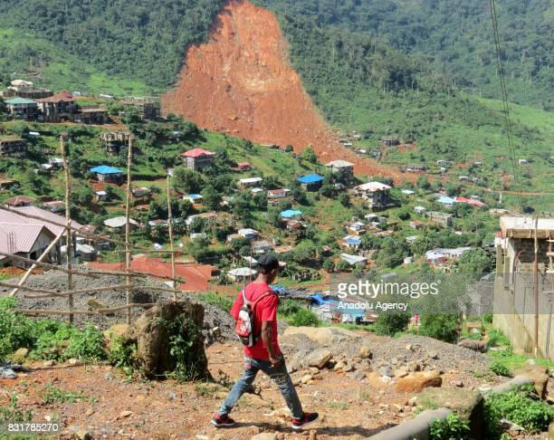 A boy walks at Regent region of Freetown after landslide struck the capital of the west African state of Sierra Leone on August 15 2017 At least 312...