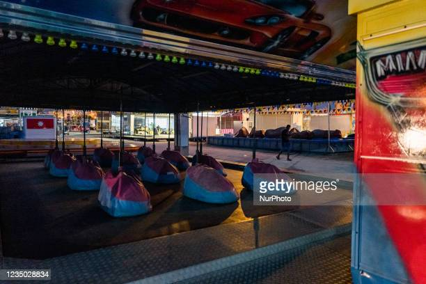 Boy walks between the rides at the Luna Park at Secca dei Pali in Molfetta, on 2 September 2021. On the occasion of the patronal feast of Our Lady of...