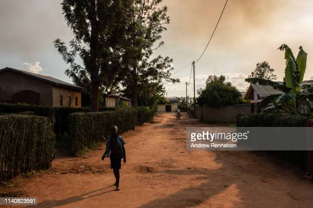 Boy walks down a street of a reconciliation village on April 06, 2019 in Rweru, Rwanda. The villages are home to both ex-perpetrators and victims of...