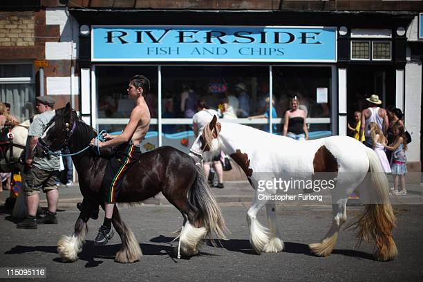 A boy walks his horses down the street at the Appleby Horse Fair on June 3 2011 in Appleby England Appleby Horse Fair has existed under the...