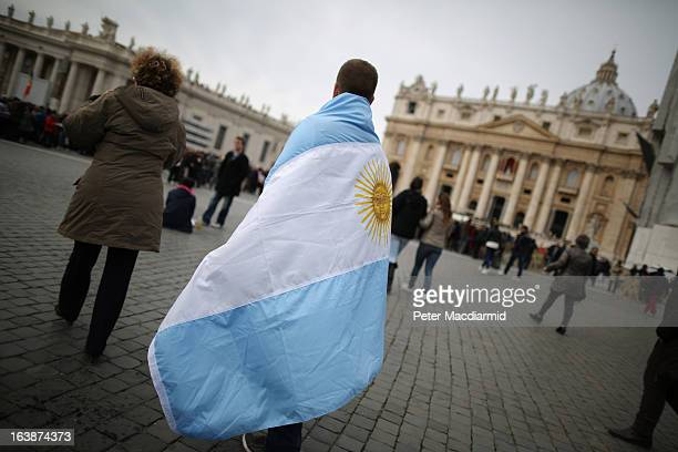A boy walks in St Peter's Square wrapped in the flag of Argentina before Pope Francis gave his first Angelus blessing on March 17 2013 in Vatican...