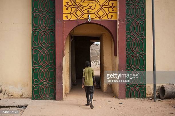 A boy walks into the Emirate's palace ahead of Eid alFitr celebration which marks the end of Ramadan in Kano northern Nigeria on July 5 2016 Kano is...
