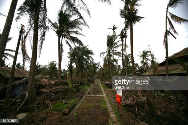A boy walks May 20 at the isolated village of Myasein Kan in the Ayeyarwaddy delta Myanmar It has been estimated that more than 100000 people were...
