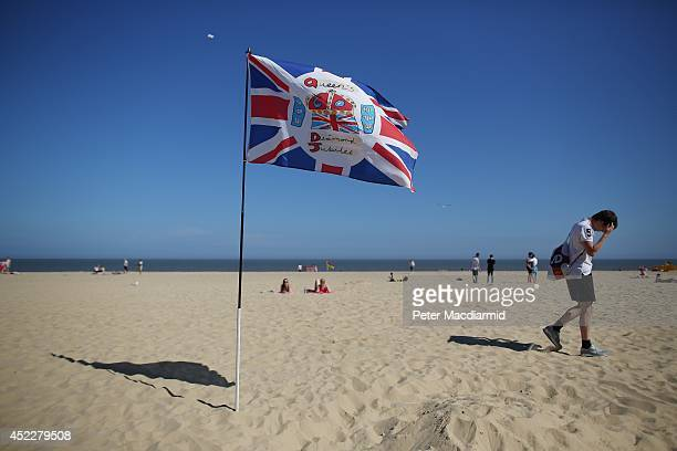 A boy walks near a diamond Jubilee flag on South Beach on July 17 2014 in Lowestoft England The Met Office has issued a heatwave alert as...