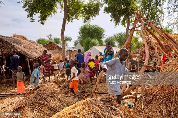 Boy walks over the remaining rooftops of homes destroyed by floodwater in Yusuf Batir refugee camp in Maban, South Sudan on November 25, 2019. -...