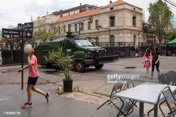 A boy walks past a police security truck at the building where the first session of the Argentine presidential debate will take place tonight on...
