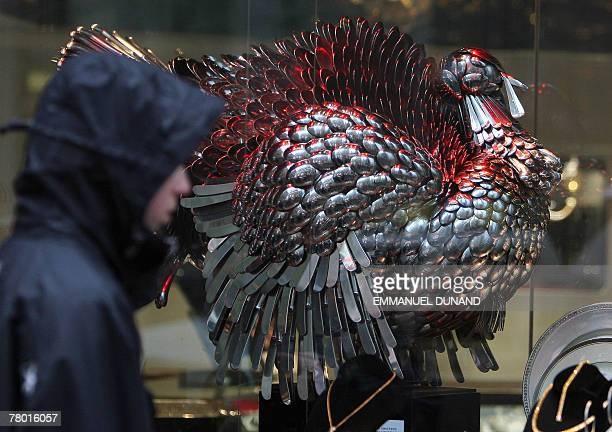 A boy walks past a turkey made of silver on display at a store ahead of Thanksgiving celebrations in New York 20 November 2007 Thanksgiving an annual...