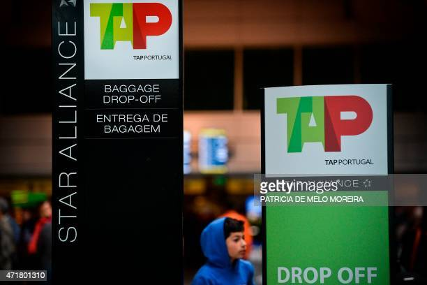 A boy walks past TAP airline's info billboards at Lisbon's Airport during a pilots strike on May 1 2015 Portuguese stateowned airline TAP pilots...