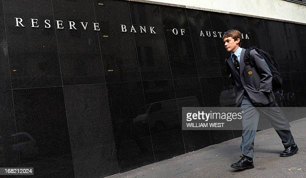 A boy walks past the Reserve Bank of Australia as Australia's central bank cut interest rates to a record low 275 percent in Sydney on May 7 2013 as...