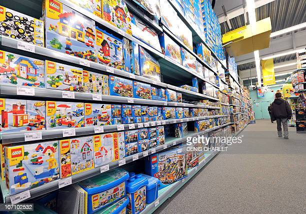 A boy walks past the shelves of La Grande Recre toys departement store in the French northern city of BruaylaBuissiere on November 20 2010 As...