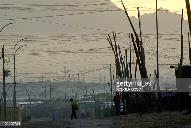 A boy walks to school on June 2 2010 in an informal settlement in Khayelitsha a poor area of shacks about 30 kms east of the center of Cape Town...