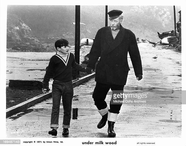 A boy walks with Peter O'Toole in a scene from the film 'Under Milk Wood' 1972