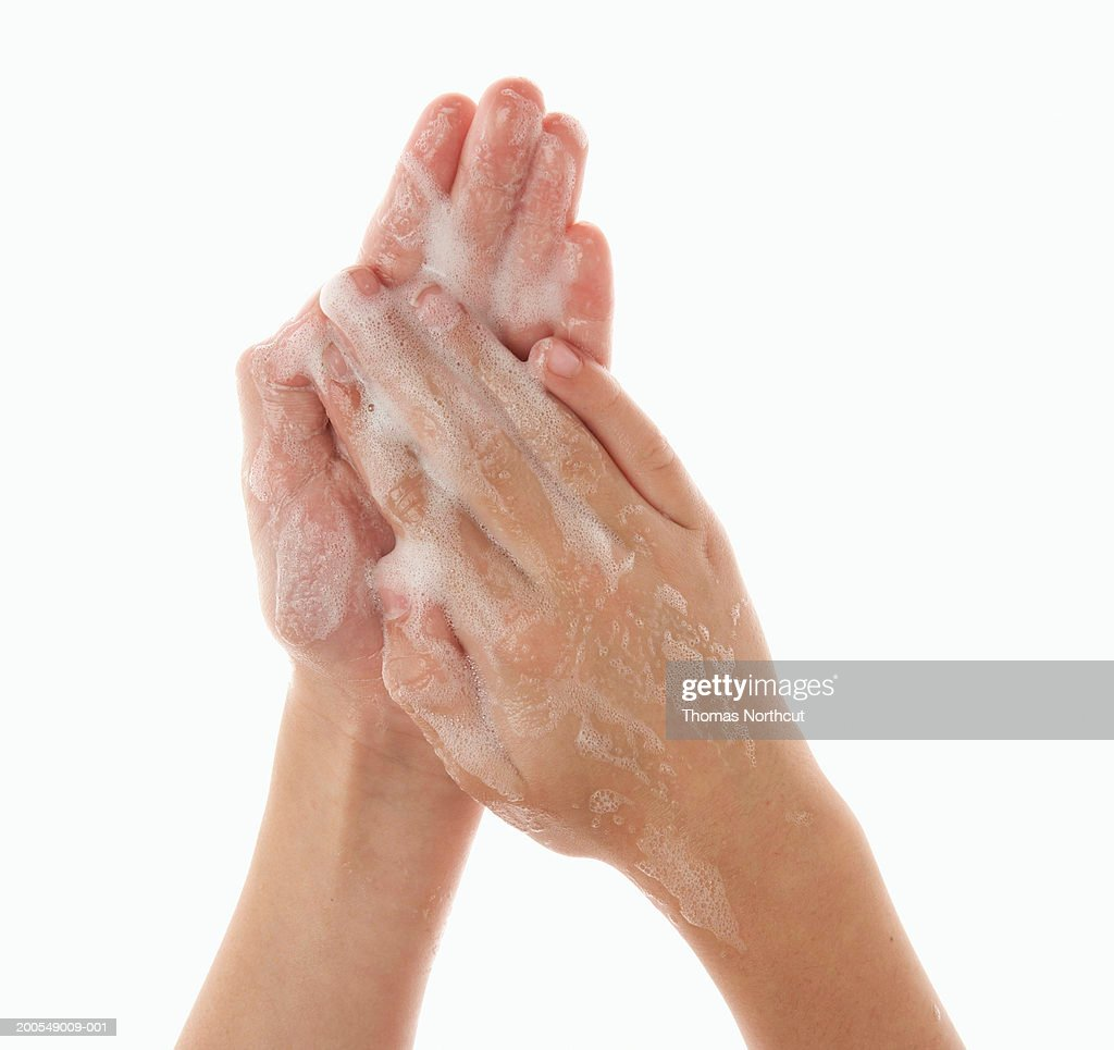 Boy (5-7) washing hands, close-up of hands : Stock Photo