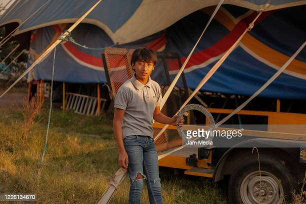 A boy watches as circus performers train amidst coronavirus on May 20 2020 in Queretaro Mexico As nonessential activities are not permitted during...