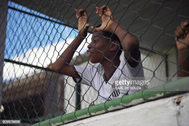 A boy watches his teammates during a trainning session at Sao Cristovao football club in Rio de Janeiro Brazil on February 7 2018 Tiny Sao Cristovao...