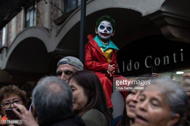 A boy watches the Day of the Dead parade on Paseo de la Reforma Avenue on November 2 2019 in Mexico City Mexico Observants celebrate the Day of the...