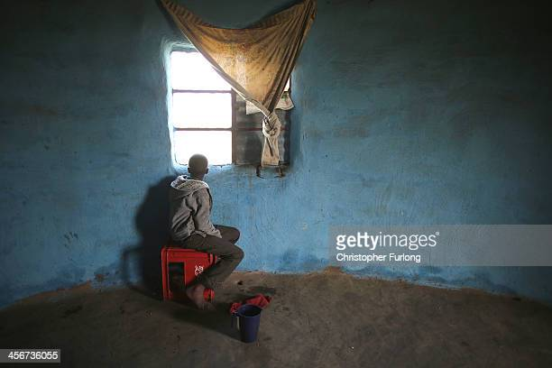 A boy watches the funeral of former South African President Nelson Mandela in the village of Qunu on December 15 2013 in Qunu South Africa Mr Mandela...