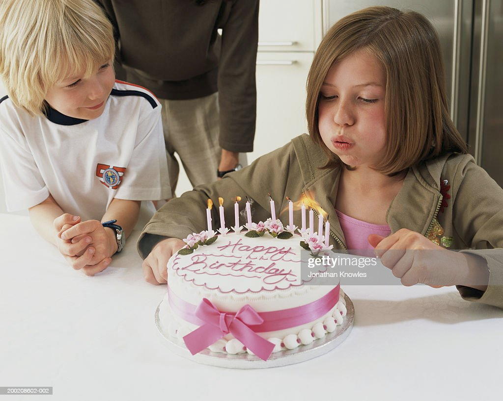 Boy Blow Out Candles On Birthday Cake Photo Getty Images