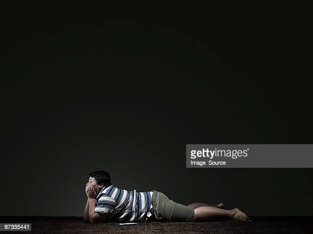 boy watching television - chubby boy stock photos and pictures