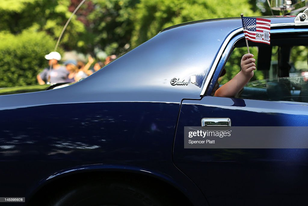 A boy waves an American flag from a car window while participating in the annual Memorial Day Parade on May 28, 2012 in Fairfield, Connecticut. Across America towns and cities will be celebrating veterans of the United States Armed Forces and the sacrifices they have made. Memorial Day is a federal holiday in America and has been celebrated since the end of the Civil War.