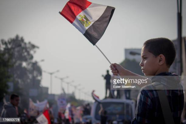 CONTENT] A boy waves an Egyptian flag at a rally for the Muslim Brotherhood at Cairo University on Saturday the 1st of December 2012