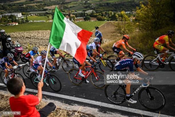 Boy waves the Italian flag as US Tayler Wiles , Spain's Margarita Garcia , Netherlands' Amy Pieters , Italy's Katia Ragusa , Britain's Hannah Barnes...