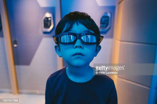 boy wearing 3d vr glasses - peter lourenco stock pictures, royalty-free photos & images