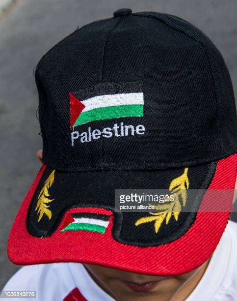 A boy wearing a basecap with the Palestinian flag and the word Palestine takes part in a protest against the closing of the border to the Gaza Strip...