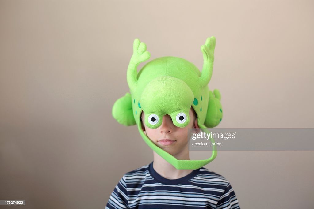 Boy wearing a frog basket hat : Stock Photo