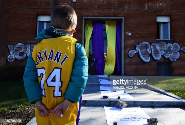 Boy, wearing a Kobe Bryant jersey, stands prior to the inauguration ceremony of a square named after late Los Angeles Lakers basketball star Kobe...
