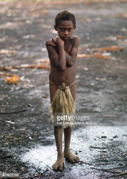 Boy wearing a penis sheath called a namba suffering from the cold Tanna island Yakel Vanuatu on September 6 2007 in Yakel Vanuatu