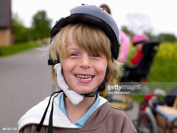 A boy wearing a safety helmet Sweden.