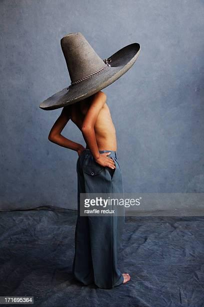 A boy wearing a sombrero