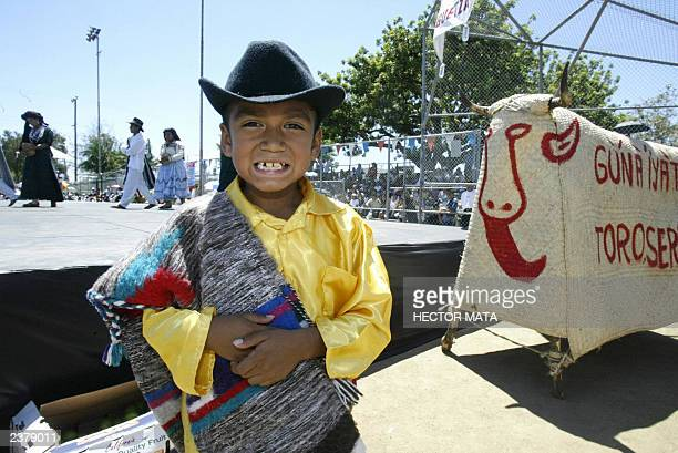 A boy wearing a traditional Oaxcan costume pose before entering the stage during the celebrations of the Guelaguetza in Los Angeles 03 August 2003...