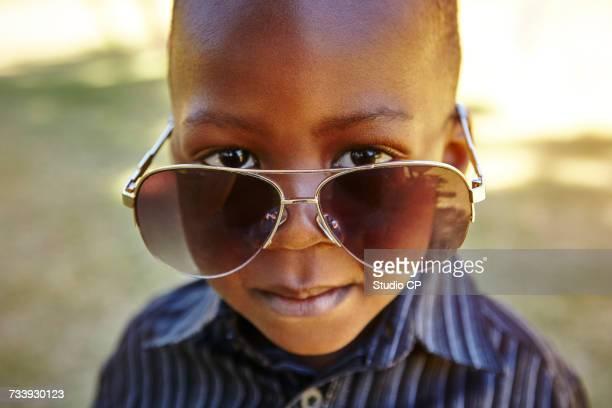 Boy wearing adult sunglasses