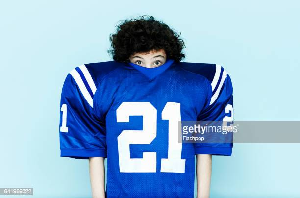 Boy wearing American football top