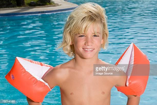 Boy wearing armbands